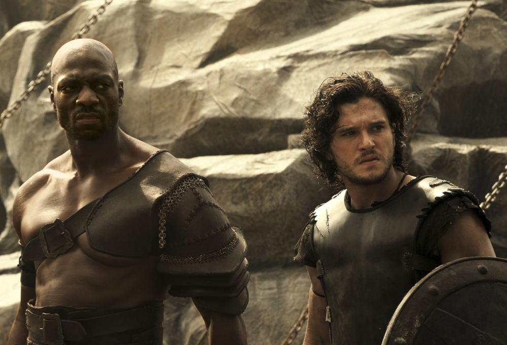 "Adewale Akinnuoye-Agbaje, left, and Kit Harington are gladiator foes who become allies in ""Pompeii."""