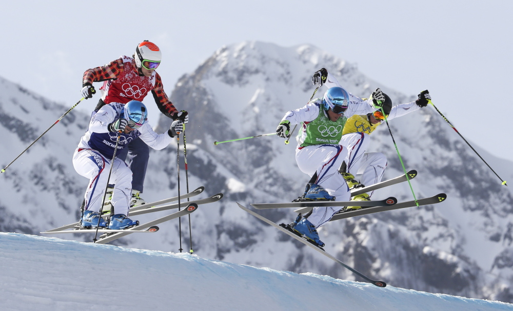 Jean Frederic Chapuis, front right, Arnaud Bovolenta, front left, Jonathan Midol, all of France, background right, and Brady Leman of Canada, background left, compete in the men's ski cross final at the 2014 Winter Olympics on Thursday. Chapuis won ahead of Bovolenta and Midol.