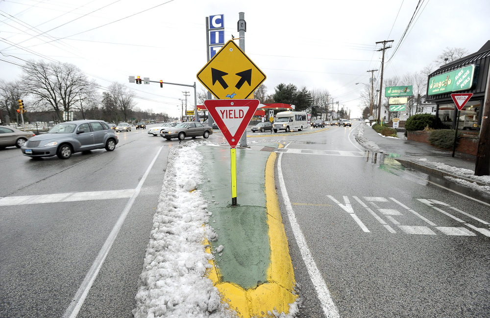 "This yield sign for the slip lane at the Five Points intersection has been replaced with a traffic light, and ""no turn on red"" signs have been posted."