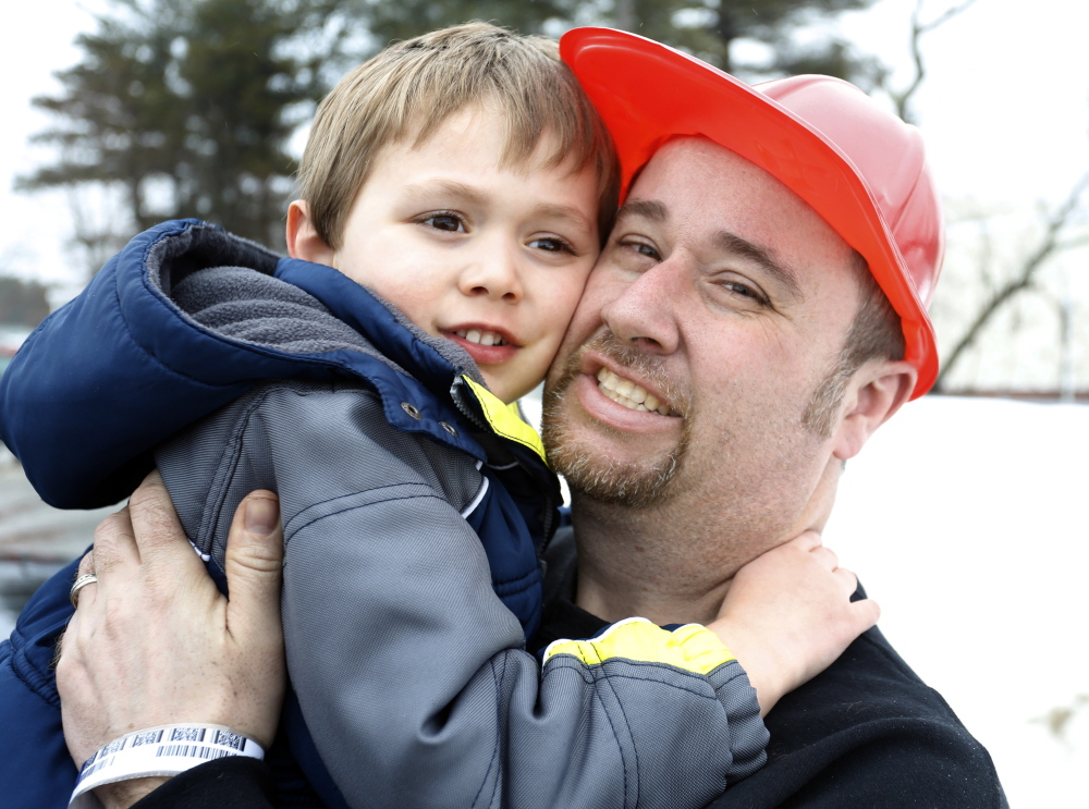 "Jon Tanguay and his son Nicholas, 4, shown together in Bath on Friday, escaped a fire Thursday at their home at 62 South St. ""I couldn't see a thing (because of the smoke),"" Tanguay said. ""Luckily, I was able to hold him."""