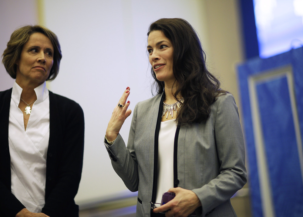 Former Olympic figure skater Nancy Kerrigan, right, stands next to NBC figure skating analyst Mary Carillo, as she speaks after a screening of a new documentary about the 1994 attack on her which will air the day of the 2014 Winter Olympics closing ceremony, Friday, Feb. 21, 2014, in Sochi, Russia. Kerrigan has been reluctant to talk about rival Tony Hardingís ex-husband hiring a hit squad to take her out before the 1994 Olympics in Lillehammer. She finally relented for a show that marks the 20-year anniversary of the incident, which thrust figure skating into the spotlight and spawned an international media frenzy. (AP Photo/David Goldman)