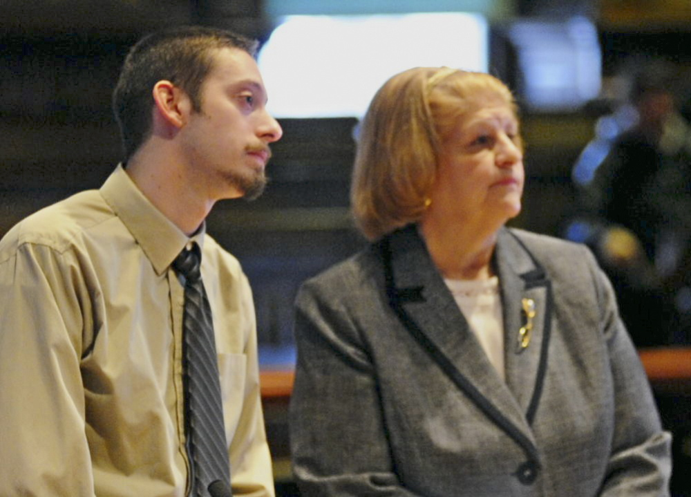 Sentenced to prison: Attorney Pam Ames, right, stands beside Joshua A. Erskine, 25, as he apologizes to the family of 81-year-old Ruth Epperson during sentencing on Friday in Kennebec County Superior Court in Augusta.