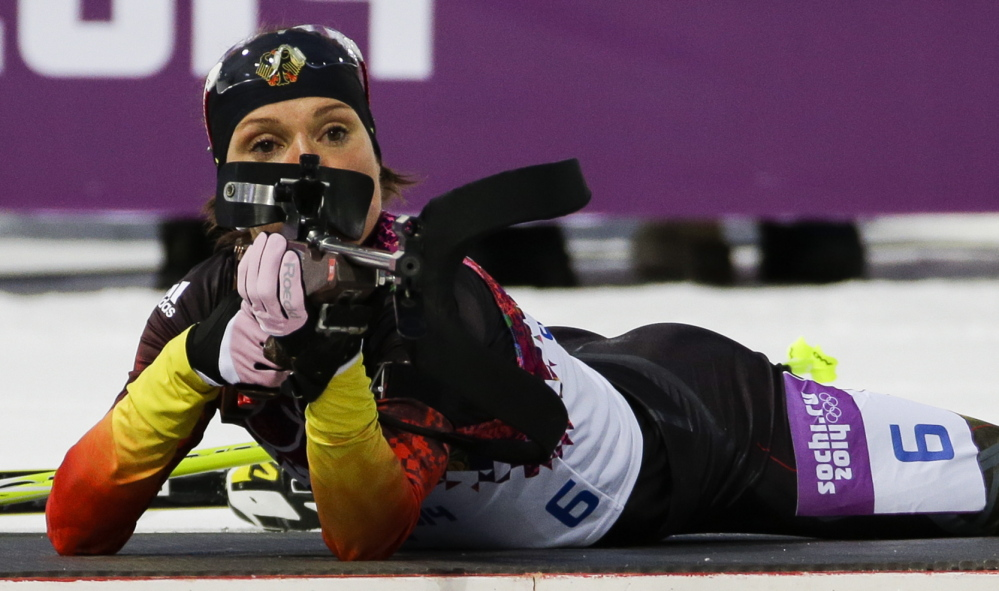 Germany's Evi Sachenbacher-Stehle prepares to shoot during the women's biathlon 7.5K sprint on Feb. 9 at the 2014 Winter Olympics, in Krasnaya Polyana, Russia. The German Olympic Committee said she tested positive on Monday for the stimulant methylhexanamine.