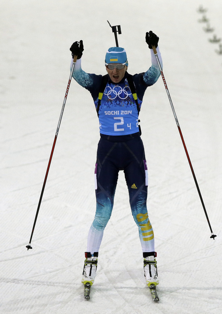 Ukraine's Olena Pidhrushna celebrates as she crosses the finish line to win the gold medal in the women's biathlon 4x6k relay at the 2014 Winter Olympics.
