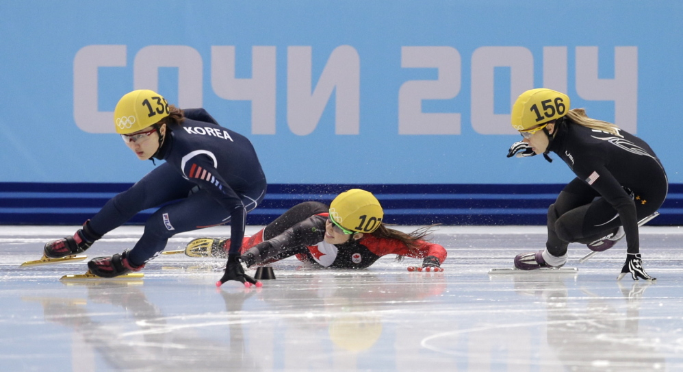 Valerie Maltais of Canada, center, crashes out as she competes with Park Seung-hi of South Korea, left, and Jessica Smith of the United States in a women's 1000-meter short track speedskating semifinal at the Iceberg Skating Palace during the 2014 Winter Olympics on Friday in Sochi, Russia.