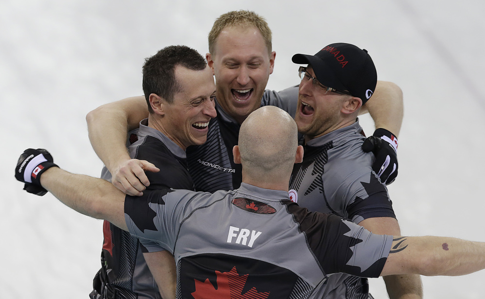 Canada's men's curling team as seen clockwise, Brad Jacobs, Ryan Harnden, Ryan Fry and E.J. Harnden celebrate after beating Britain to win the men's curling gold medal game.