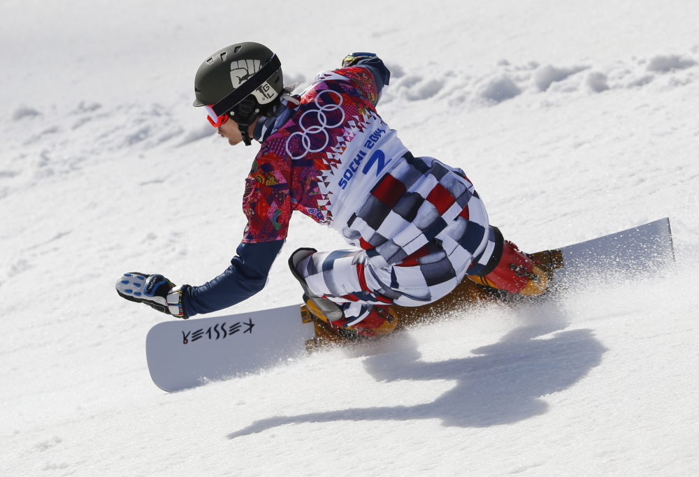 Russia's Vic Wild competes during snowboard parallel slalom qualifying at the Rosa Khutor Extreme Park at the 2014 Winter Olympics on Saturday in Krasnaya Polyana, Russia.