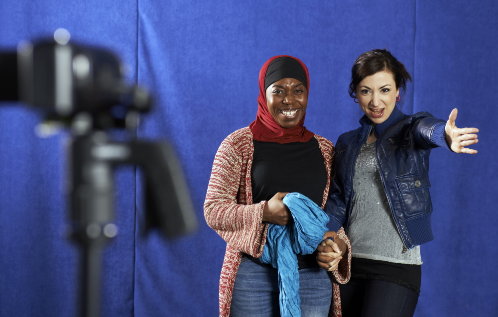 "Samar (Hend Ayoub) directs Intisar (Donnetta Lavinia Grays) in a video about veiling for her blog in the Portland Stage Company production of Tom Coash's ""Veils."""