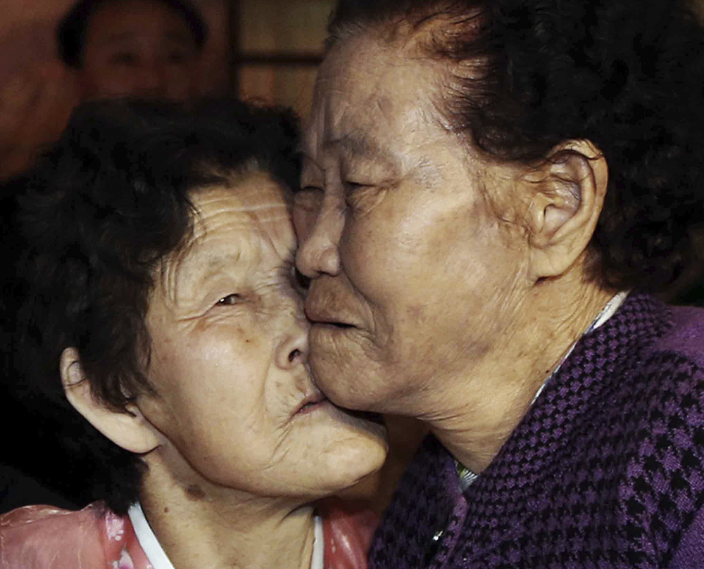 South Korean Lee Chun Hwa, right, gets a kiss from her North Korean sister, Lee Chun Son, at the Diamond Mountain resort in North Korea on Saturday. The siblings had been separated for six decades.
