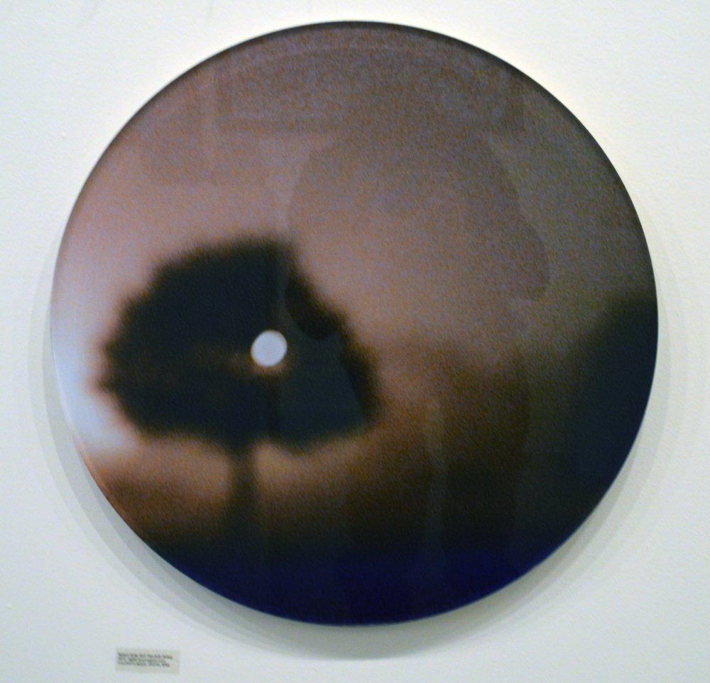 "Photographic tondo face-mounted on Lucite by Robert Hyde, in ""Free For All 4."""