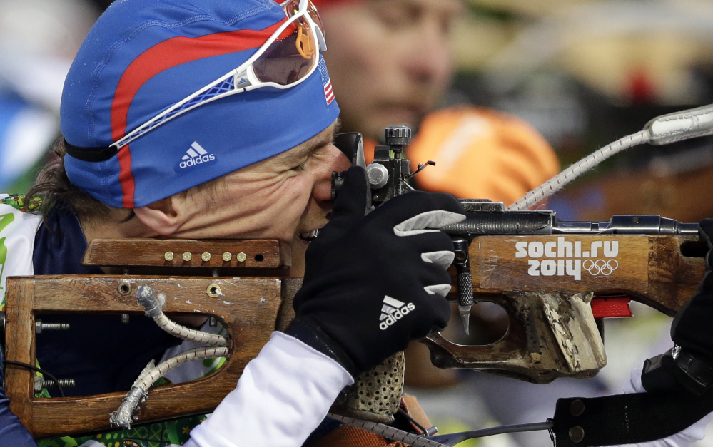 United States' Russell Currier of Stockholm, Maine, shoots during the men's biathlon 4x7.5K relay at the 2014 Winter Olympics Saturday in Krasnaya Polyana, Russia.
