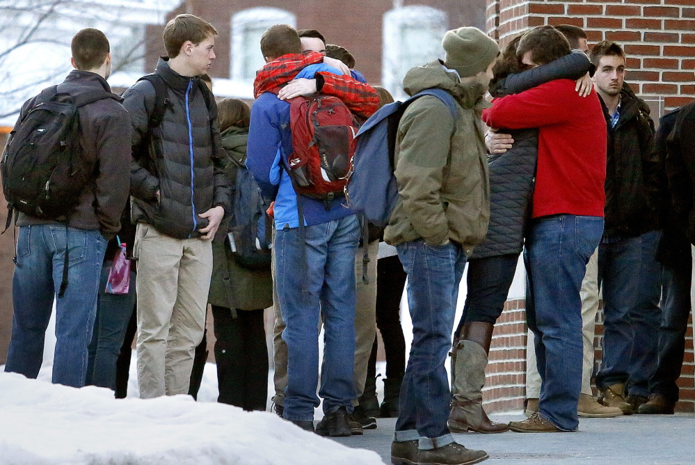 Emotions run high Monday as mourners pour out of Pettengill Hall at Bates College after a memorial service for John Durkin.