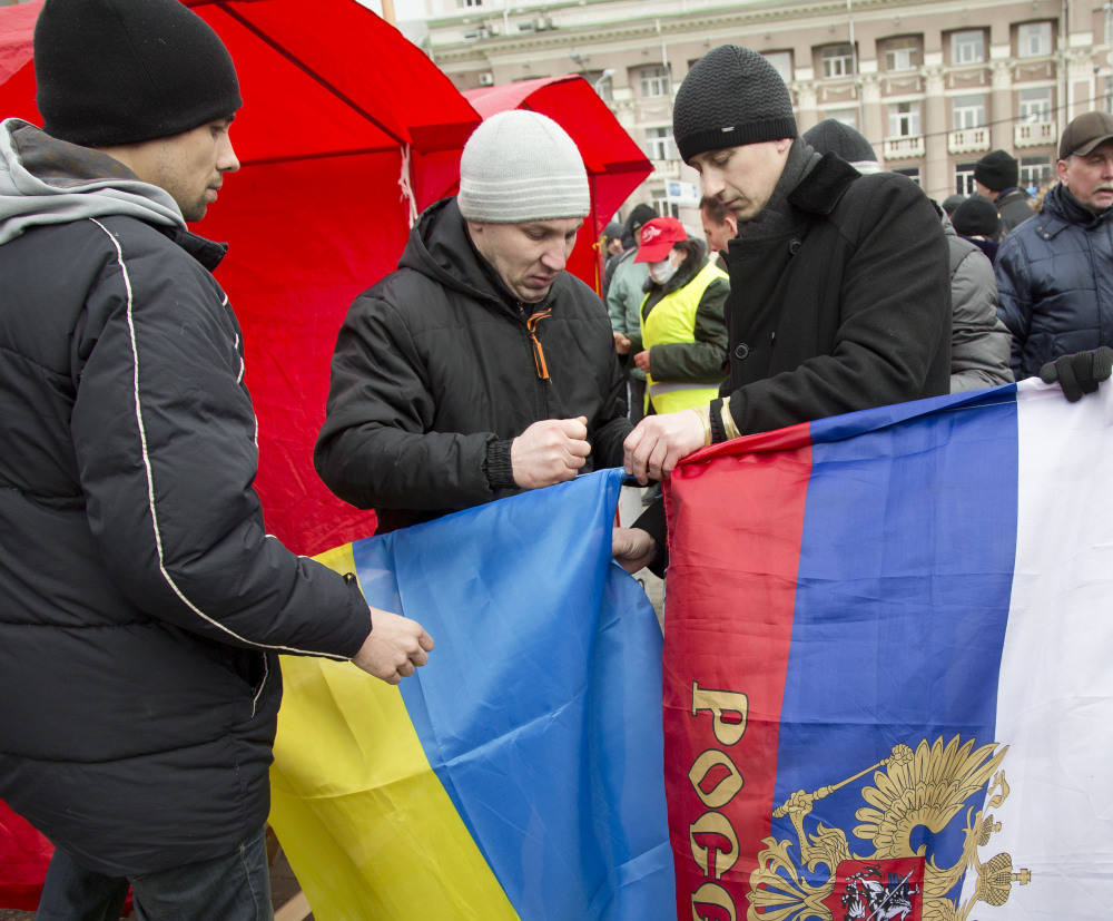 Ukrainian and Russian flags are displayed in Donetsk, eastern Ukraine, on Tuesday.