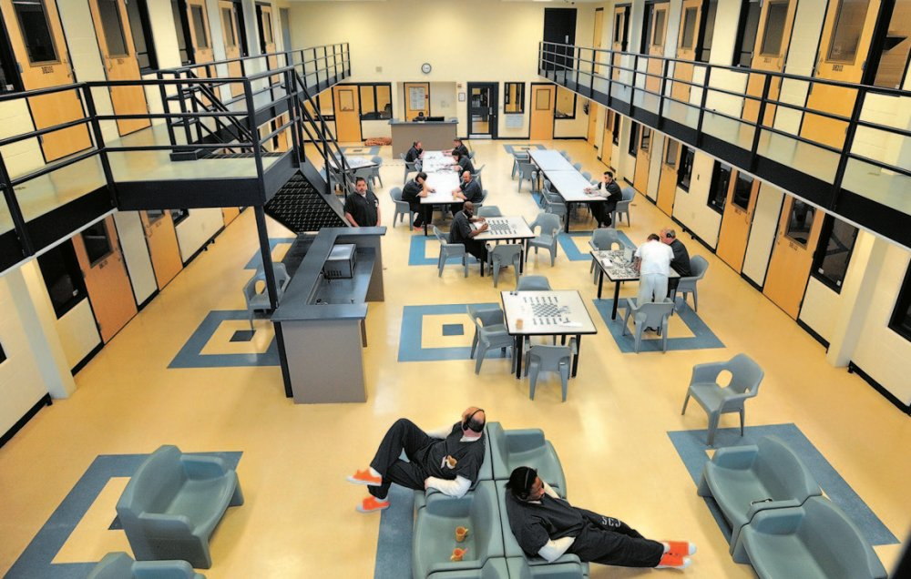Inmates occupy the day room of the medium-security wing at the Somerset County Jail in East Madison last winter. At issue in the case was the control of revenue from boarding federal prisoners.