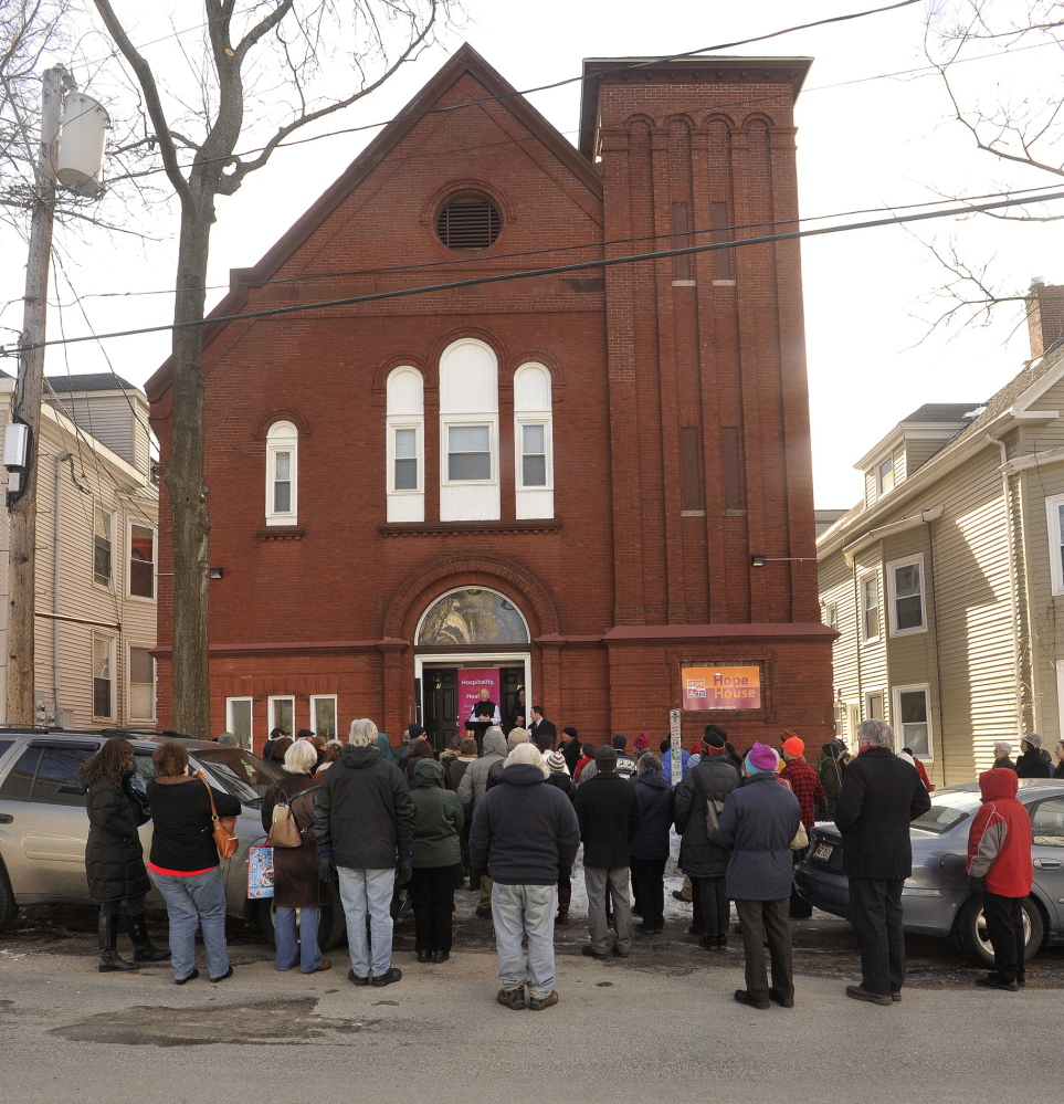 More than 50 people gather Tuesday on Sherman Street to celebrate Hope House, a recently completed home for newcomers who arrive in Portland alone and in need. The building, a former Lutheran church, has five apartments and a common living space.
