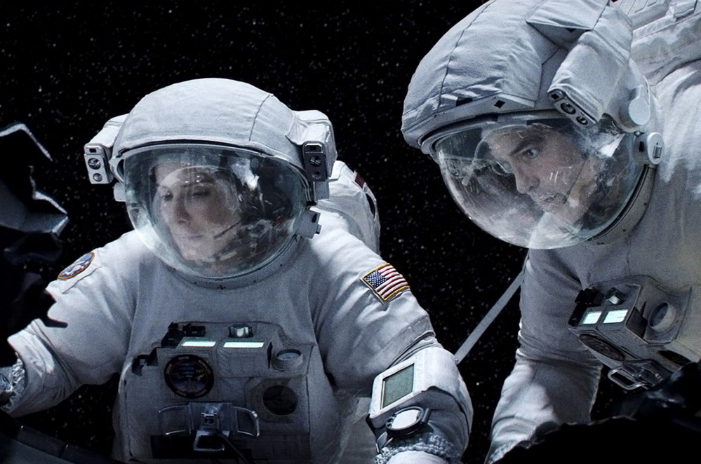 "Sandra Bullock and George Clooney in ""Gravity."""