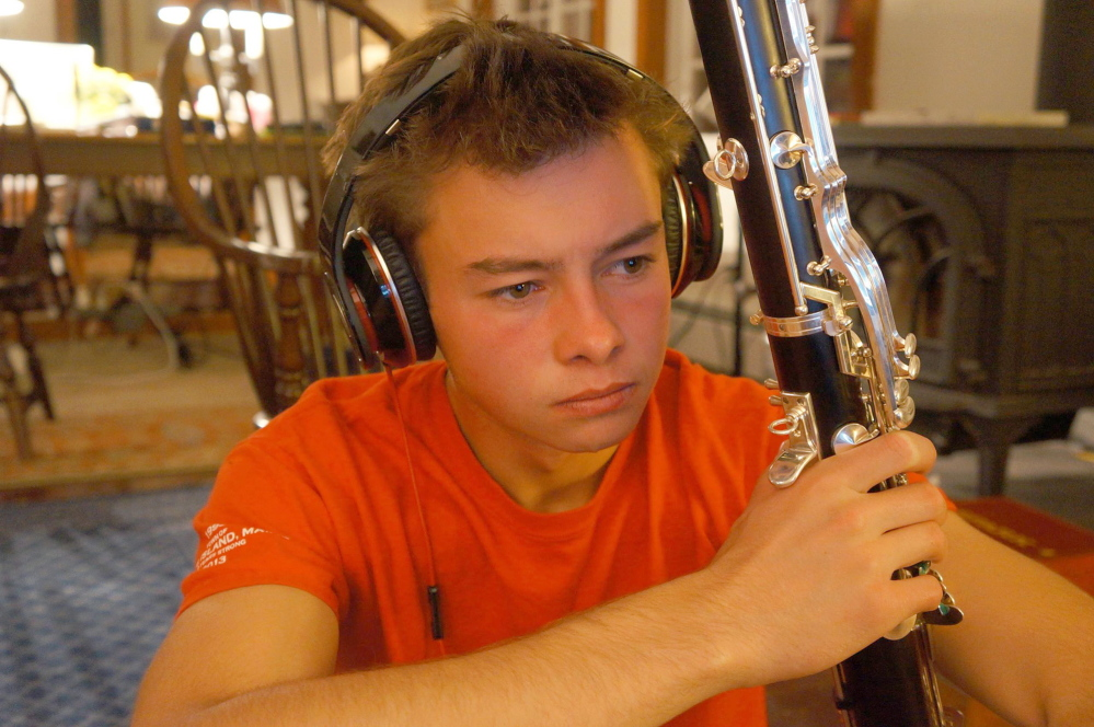 Benjamin Edward LaMontagne holds his bass clarinet, an uncommon instrument to take up early in life. He also played trumpet, bassoon, saxophone and English concertina.