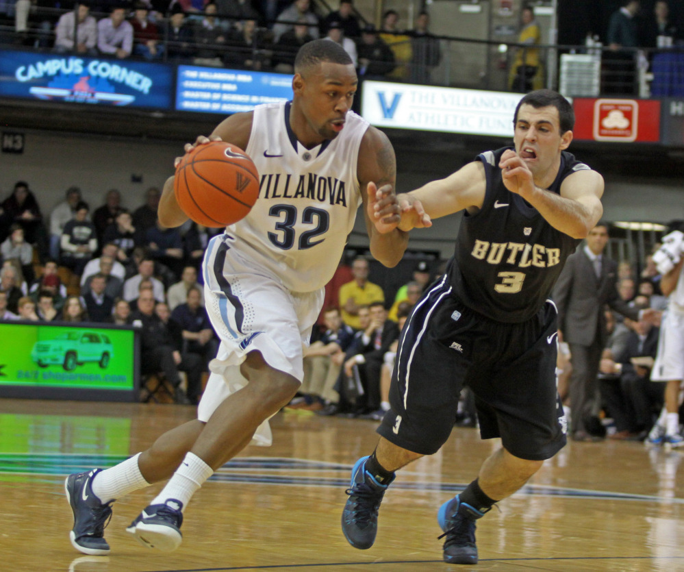 Butler's Alex Barlow defends as Villanova's James Bell drives into the lane during the first half of Villanova's 67-48 win at home on Wednesday night.