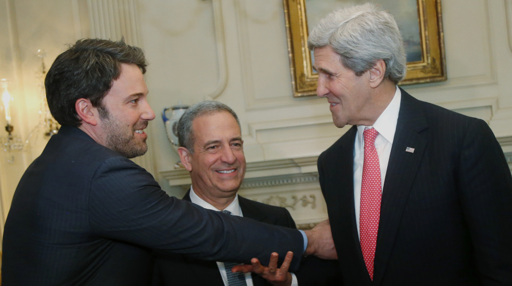 Ben Affleck, from left, ex-Sen. Russ Feingold, the special envoy for the African Great Lakes region, and Secretary of State John Kerry meet Wednesday in Washington.