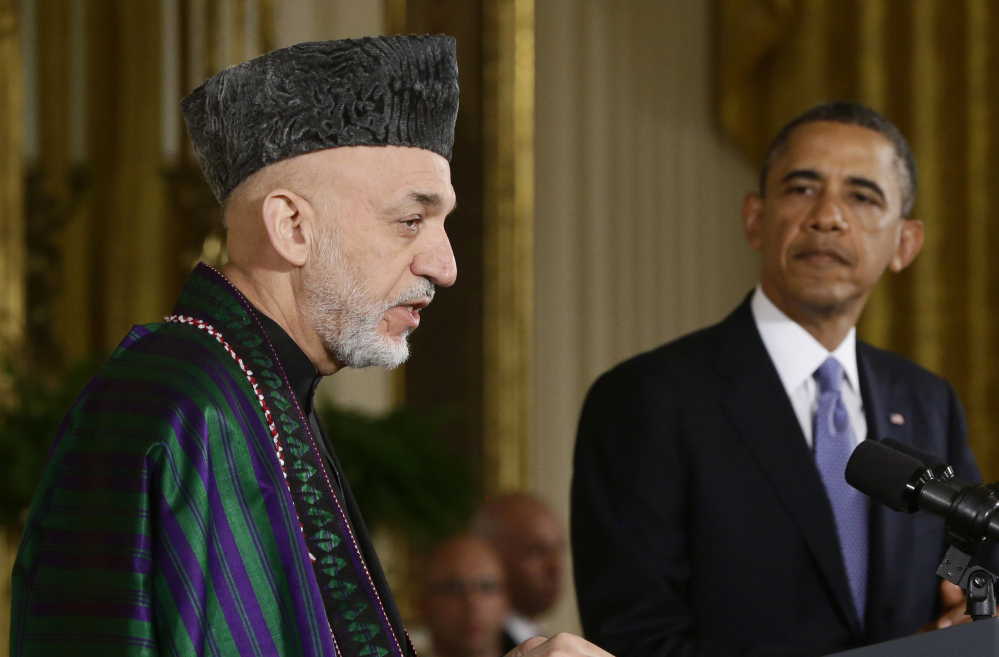 President Obama listens as Afghan President Hamid Karzai speaks at a news conference in Washington in 2013.