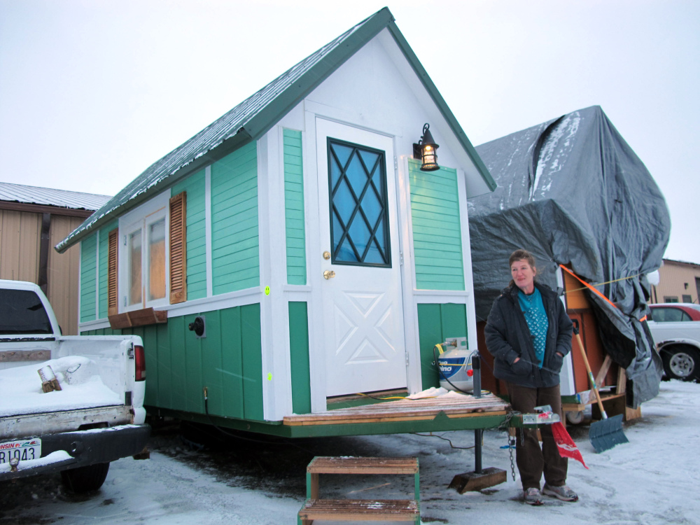 Betty Ybarra, 48, stands outside a tiny houses she and her boyfriend live in, in Madison, Wis. The Associated Press