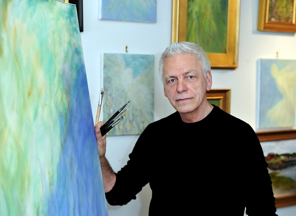 Paul Noel in his studio in Wells with some of the paintings that will be in his show at Whitney Galleries in Ogunquit.