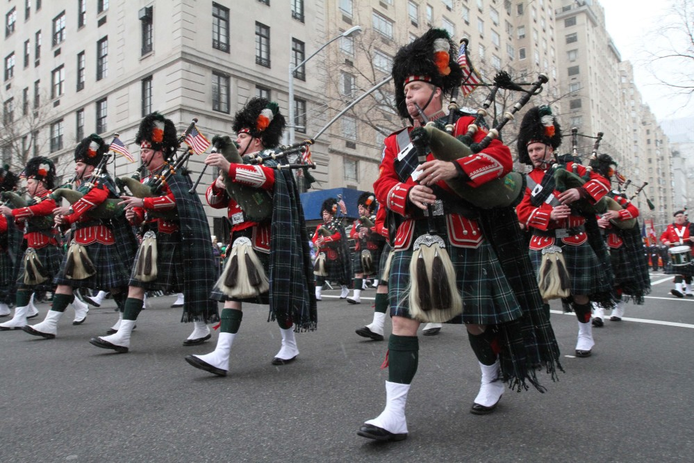 Members of the New York City Fire Department's Emerald Society Pipes and Drums make their way up New York's Fifth Avenue as they take part in the 2013 St. Patrick's Day Parade.
