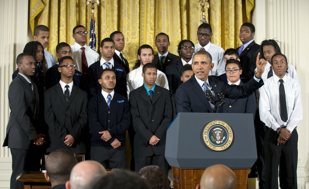 """President Obama gestures during an event in the East Room of the White House to promote his """"My Brother's Keeper"""" initiative Thursday in Washington."""