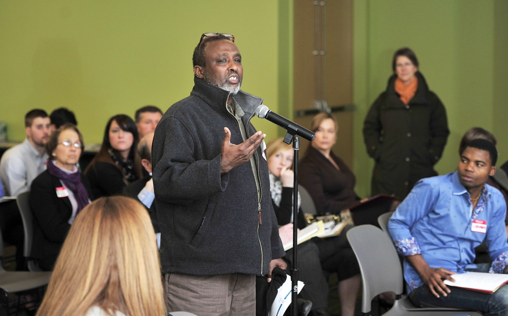 Mohamud Barre, executive director of Maine Access Immigrant Network, asks questions Thursday as representatives of the hotel industry and refugee assistance groups and city officials meet at the Portland Public Library to discuss ways to improve job opportunities for immigrants in Portland's growing hospitality sector.