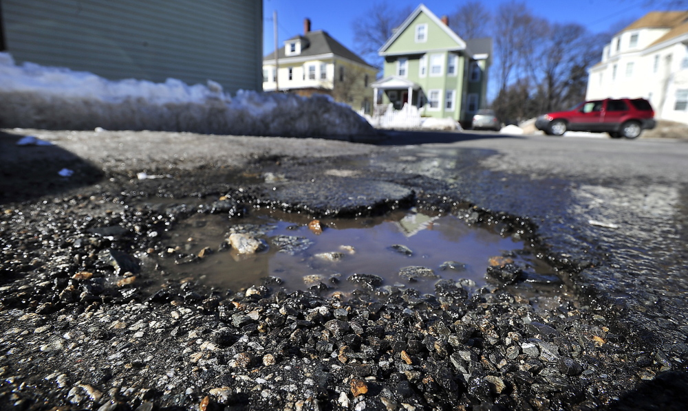 Potholes like this one on a side street off Woodford Street in Portland appear to be more common and worse than usual.