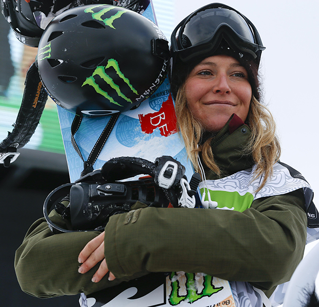 Jamie Anderson stands on the podium after winning the women's slopestyle snowboarding final at the Dew Tour iON Mountain Championships, Friday, Dec. 13, 2013, in Breckenridge, Colo.
