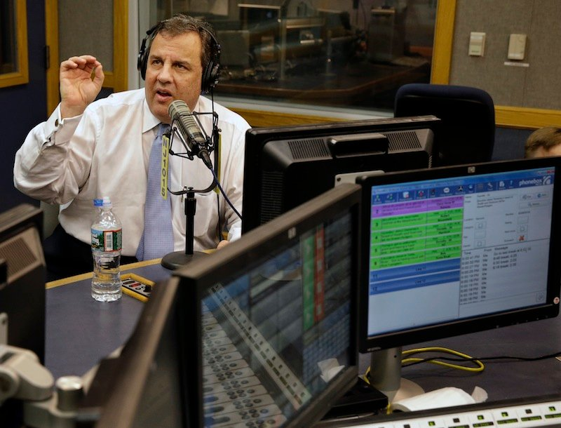 New Jersey Gov. Chris Christie sits in a studio during his radio program,