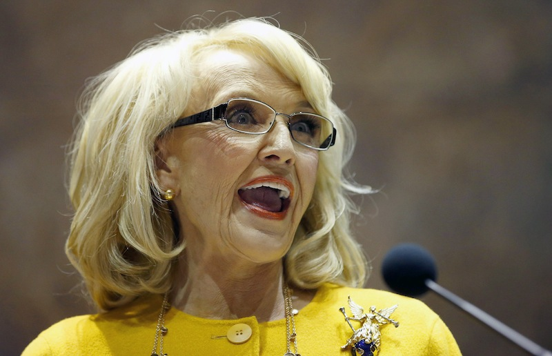 Arizona Gov. Jan Brewer on Wednesday vetoed a Republican bill that set off a national debate over gay rights, religion and discrimination and subjected Arizona to blistering criticism from major corporations and political leaders from both parties.