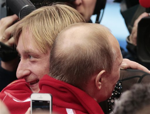 Russian President Vladimir Putin, right, embraces Evgeni Plushenko after Russia placed first in the team figure skating competition at the Iceberg Skating Palace during the 2014 Winter Olympics, Sunday, Feb. 9, 2014, in Sochi, Russia. (AP Photo/Ivan Sekretarev) 2014 Sochi Olympic Games;Winter Olympic games;Olympic games;Sports;Events;XXII Olympic Winter Games