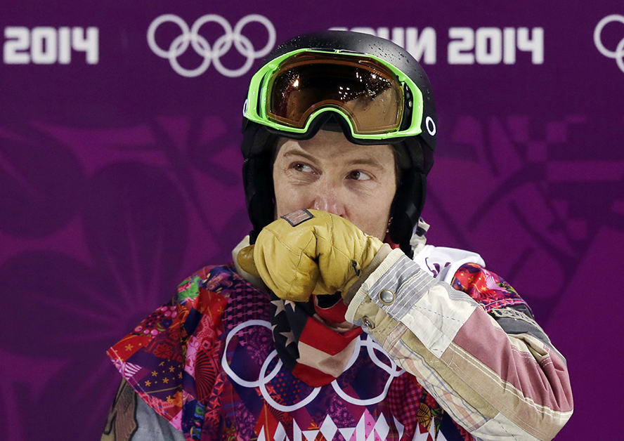 Shaun White of the United States wipes his face after colliding the edge of the half pipe during the men's snowboard halfpipe final at the Rosa Khutor Extreme Park, at the 2014 Winter Olympics Tuesday. 2014 Sochi Olympic Games;Winter Olympic games;Olympic games;Spor