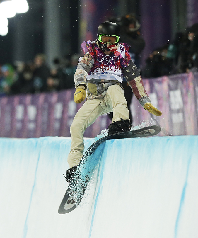 Shaun White of the United States hits the edge of the half pipe during the men's snowboard halfpipe final at the Rosa Khutor Extreme Park, at the 2014 Winter Olympics. 2014 Sochi Olympic Games;Winter Olympic games;Olympic games;Spor