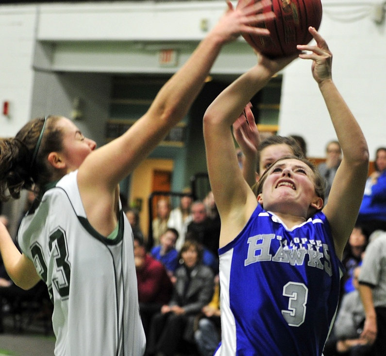 Waynflete #23, Leigh Fernandez, blocks a layup attempt by Sacopee Valley #3, Morgan Sanborn, on Tuesday.