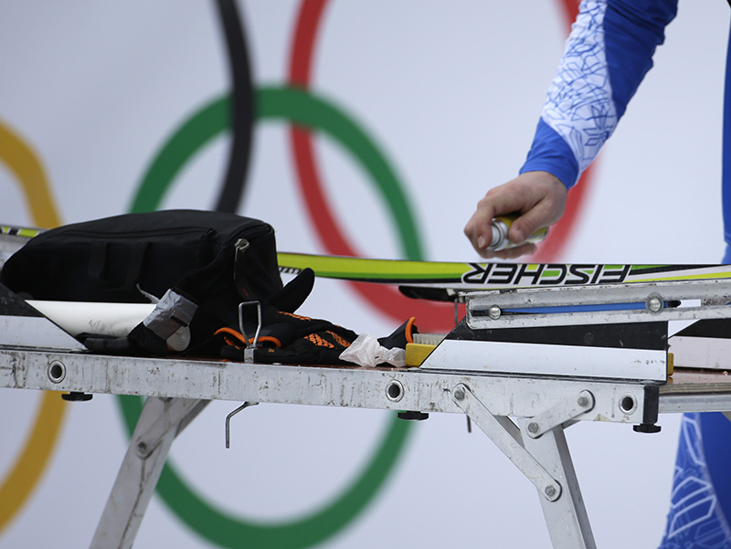 A service technician waxes a ski prior to the cross-country sprint competitions at the 2014 Winter Olympics, Tuesday, Feb. 11, 2014, in Krasnaya Polyana, Russia.