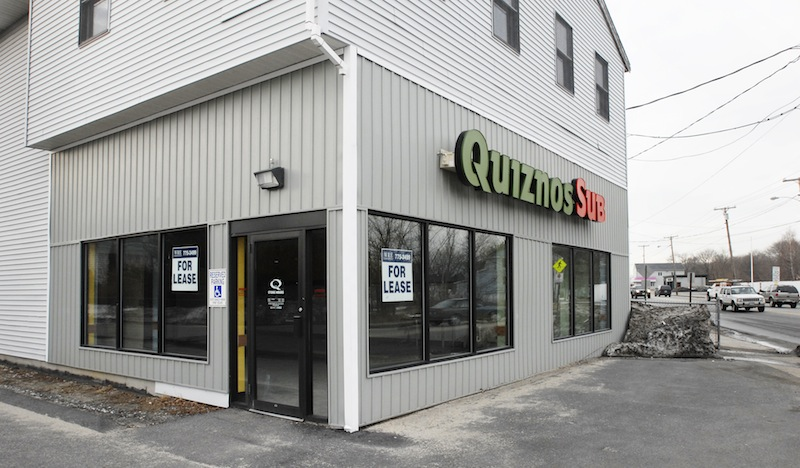 In this March 2007 file photo, a recently closed Quiznos at 726 Forest Ave. in Portland, Maine. Denver-based Quiznos has filed for Chapter 11 bankruptcy protection to reduce its debt by more than $400 million after the chain lost ground to its competitors. Fast food