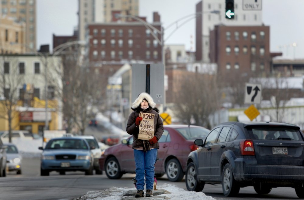 Laurel Merchant panhandles in February in the median at Preble Street Extension and Marginal Way in Portland. The city has received a 30-day extension to decide whether or not to appeal a federal court ruling that struck down a ban on loitering and panhandling in street medians.