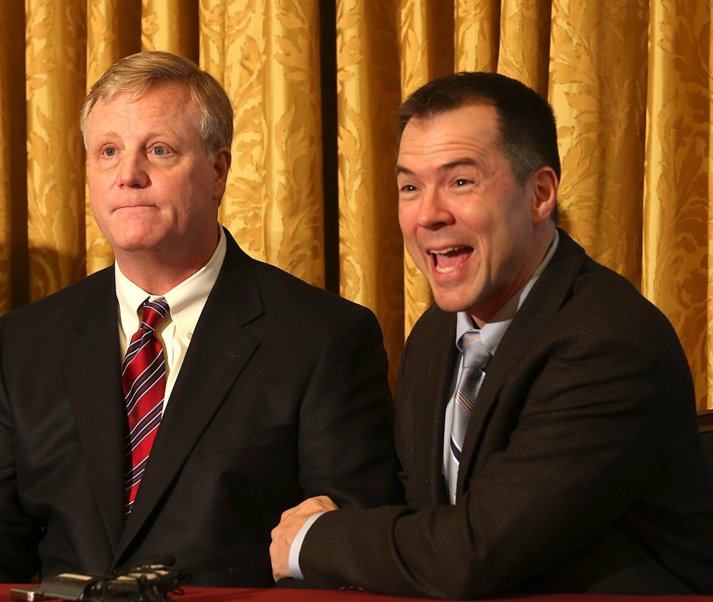 Gay couple Mark Phariss, left, and Victor Holmes, react during a news conference in San Antonio on Wednesday.
