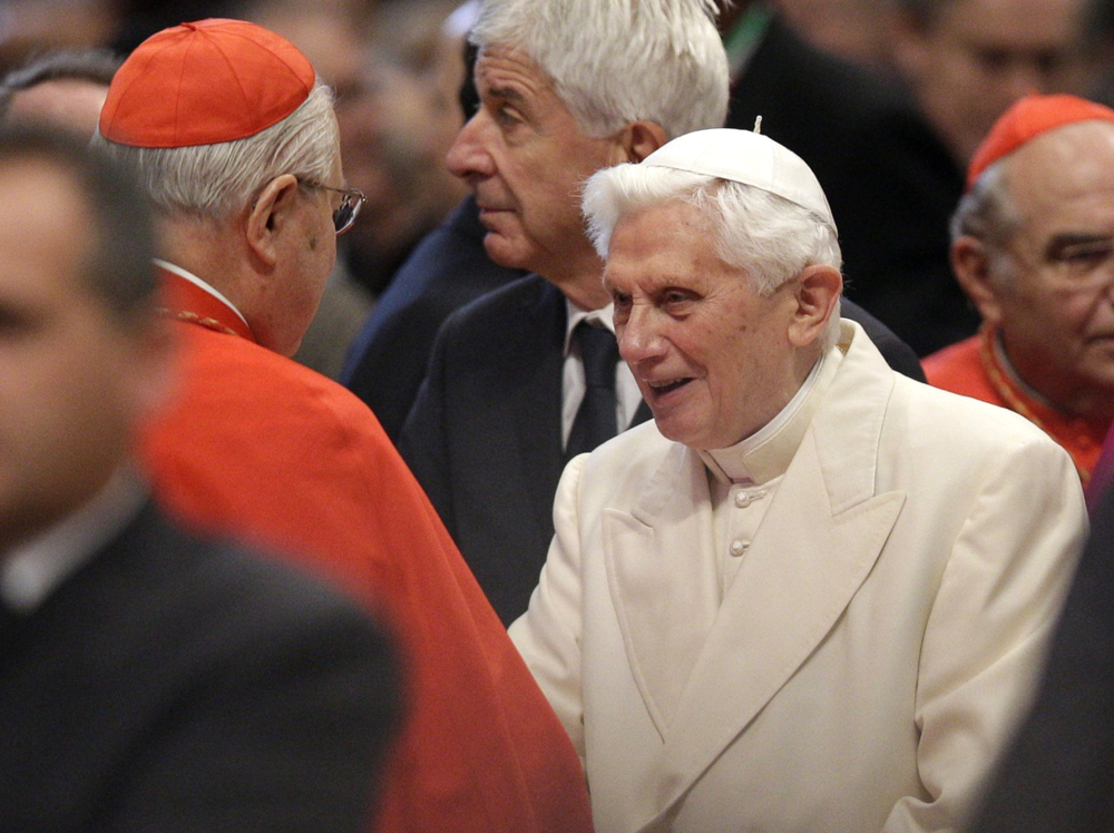Pope Emeritus Benedict XVI is greeted by Cardinal Angelo Sodano, left, as he arrives for a consistory inside St. Peter's Basilica at the Vatican last Saturday.