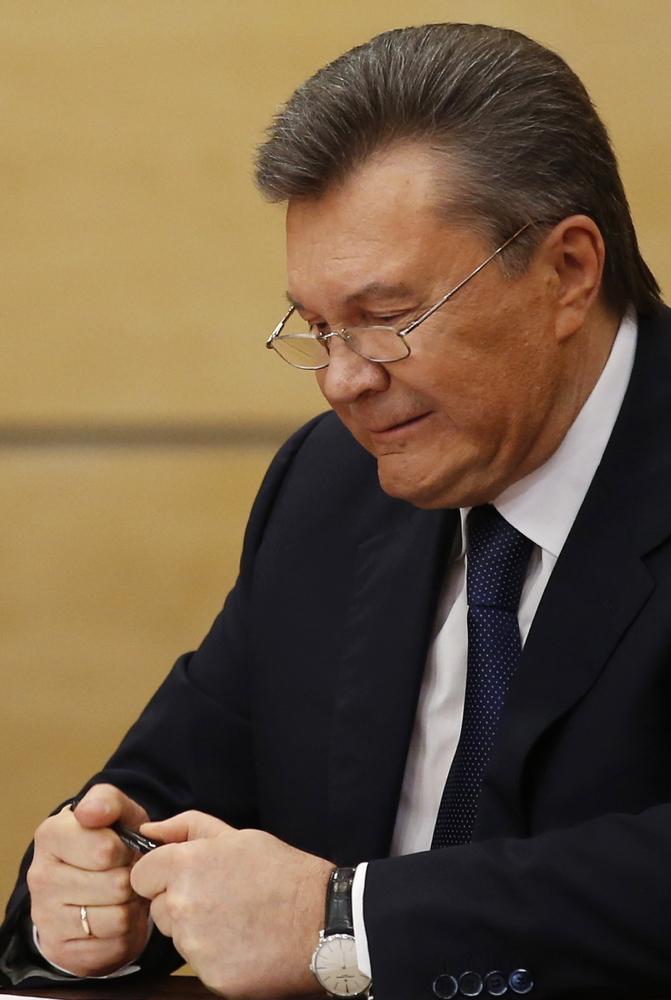Ousted Ukrainian President Viktor Yanukovych speaks in Russia on Friday. It was his decision to make a trade deal with Russia instead of the EU that ignited the latest revolution in Ukraine.