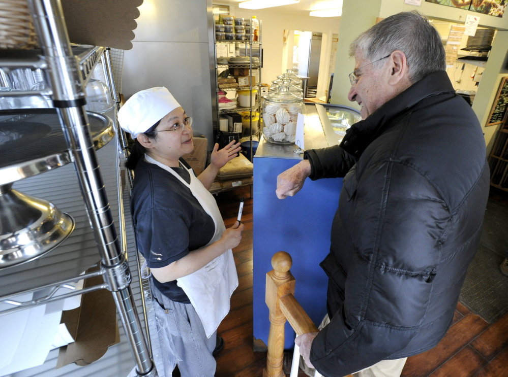 Independent Eliot Cutler talks with Irene Lim, owner of Fernleaf Bakery in Saco, on Wednesday. Cutler has been campaigning as though the election were weeks away, a political necessity for lack of a ready-made platform.