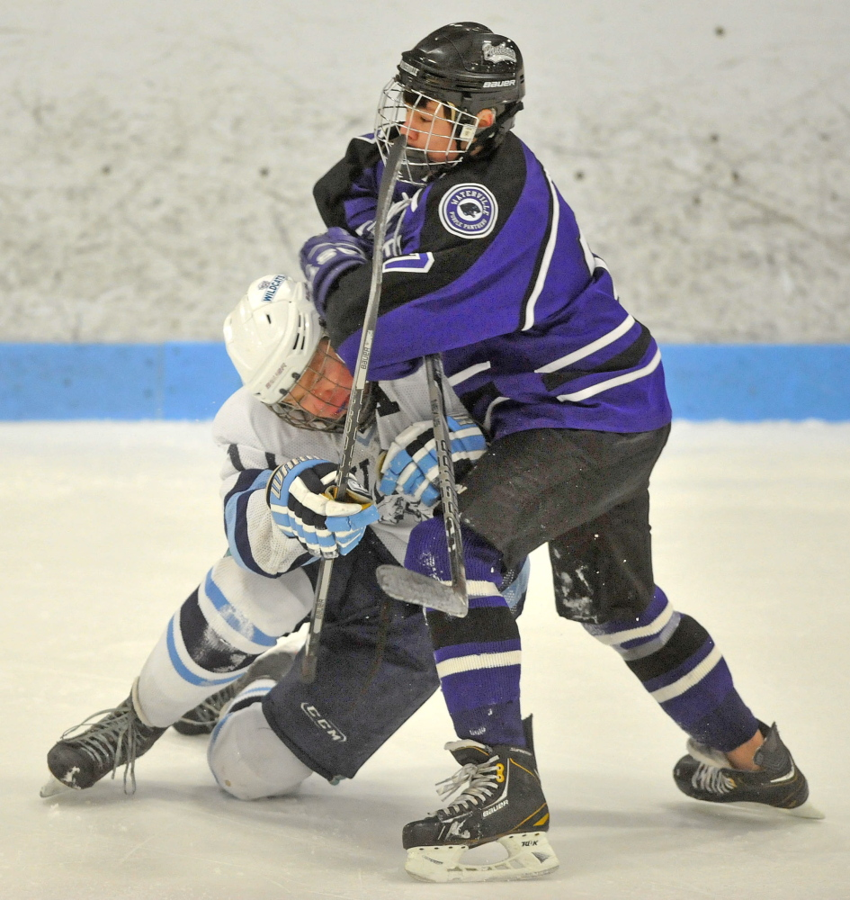 Waterville's Nick Denis, right, collides with Presque Isle's Andrew Michaud during an Eastern Class B boys' hockey semifinal Saturday at Sukee Arena in Winslow. Presque Isle won, 5-4.