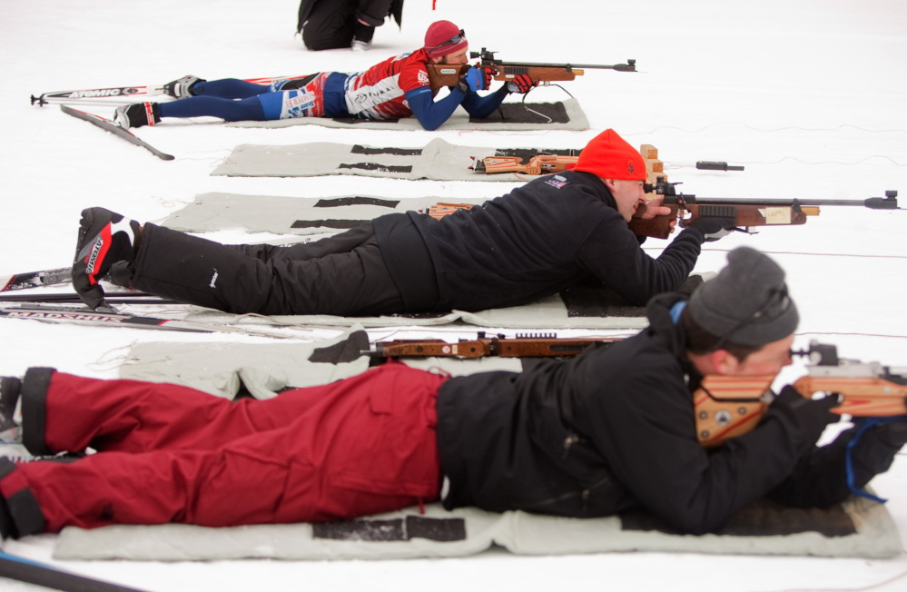 Members of Team Semper Fi target shoot during a biathlon at Pineland Farms in New Gloucester on Sunday. A group of 15 wounded combat veterans participated in the event, hosted by Pineland Farms' Veterans Adaptive Sports and Training program.