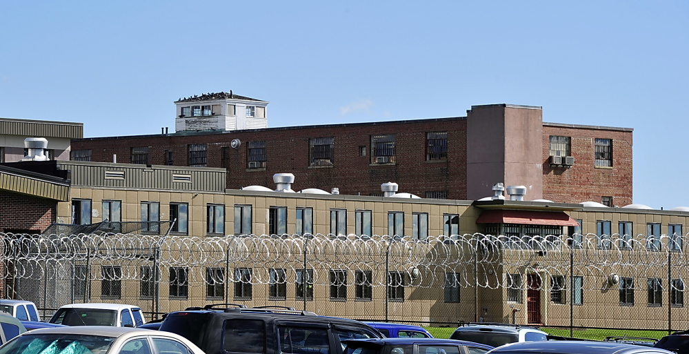 An exterior of Maine Correctional Center in October 2013 shows a security fence and razor wire that keeps prisoners inside the facility.