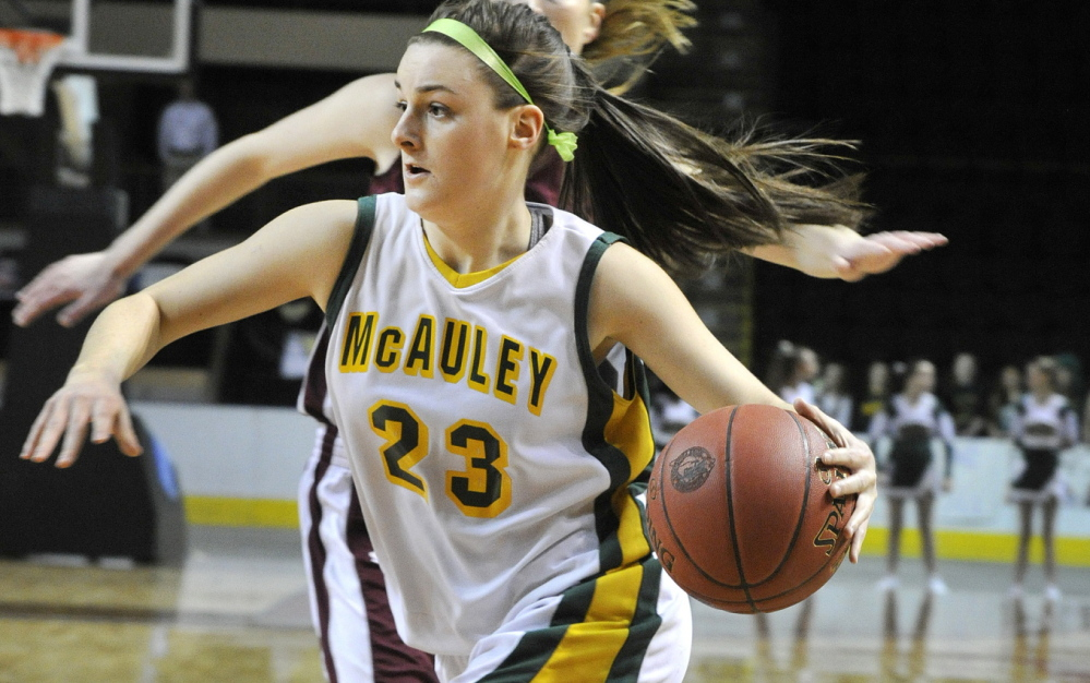 McAuley guard Allie Clement drives to the basket last month.