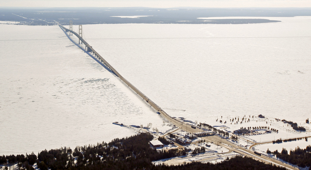 This aerial photo shows the Mackinac Bridge, which spans a freshwater channel that separates Michigan's upper and lower peninsulas. The strait is drawing attention for the 20-inch pipelines that stretch across the bottom of the waterway.