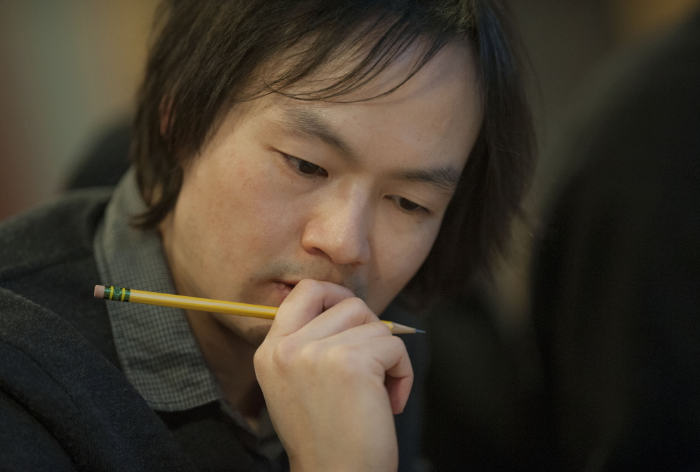 Composer Christopher Tin follows the audio recording in studio D, Saturday, January 18, 2014 on campus in Bangor, Maine.